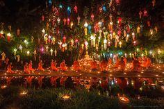 Monks celebrating Thai festival of lights - Loy Krathong. Thailand.