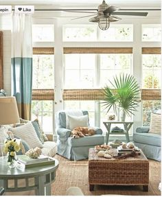 coastal living room. I need a lake house.  Love the nautical fan and bamboo shades for PGI house are growing on me.