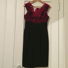 Black and red cocktail dress. Form fitting around hips and waist with off the shoulder sleeves. London Times Dresses