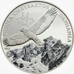 Mongolia Coins - 500 Togrog Silver coin of 2013, Golden Eagle Wildlife.  This Silver Commemorative coin from Mongolia shows a circling Golden Eagle in front of a snow-covered mountain glistening in the sunlight.