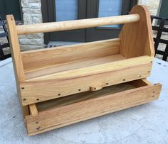 Carpenter's tool box with pullout drawer. Main frame is cypress; front drawer panel is red oak and handle is maple. Back has storage for hand saw.