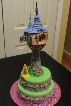 Amazing rapunzel tower cake. My research last year showed that most people made the tower out of rice krispie treats & decorated it. I'm just not quite skilled enough for that yet :P