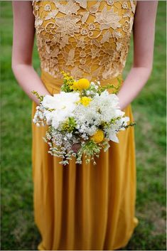 Mustard bridesmaid dress in lace and chiffon with a U back. Love the billy button bouquet Buy It Here:   http://www.forherandforhim.com/lace-and-chiffon-u-back-dress_1656.html#.Vo2O9vF3QUE