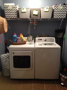 I recently changed my Laundry Room walls from a country red to antique blue. The lighter color really brightened the room. I added storage bins that I purchased at Lowes then made tags for each bin description. Also a lost sock container is a must.
