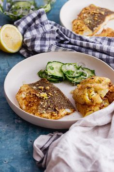This lightly spiced oven baked fish is coated in ras el hanout and cooked until flakey. It's served with a light and fresh cucumber and shallot salad for an easy and delicious summer meal! #thecookreport #bakedfish #spicedfish #summerrecipe Spicy Recipes, Fish Recipes, Seafood Recipes, Healthy Recipes, Delicious Recipes, Crockpot Recipes, Easy Dinner Recipes, Summer Recipes, Lunch Recipes