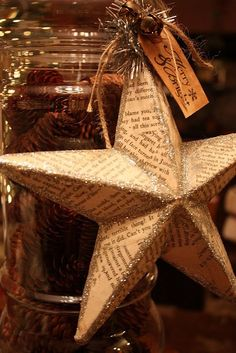 DIY glitter stars. You can make these using this tutorial: http://greylustergirl.blogspot.com/2011/06/3-d-cardboard-star.html. Decoupage some torn up pages from an old book over it, add some lines of glitter and voila!
