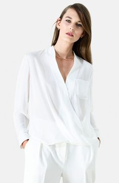 Free shipping and returns on Topshop Surplice Pocket Blouse at Nordstrom.com. A pocket-detailed blouse earns feminine appeal from a draping wrapped front that imparts movement and a plunging neckline.