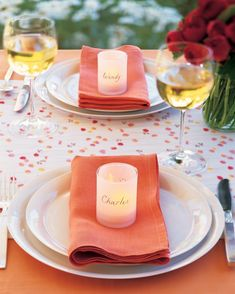 Your guests will love seeing their names in lights. These glowing place cards are votive holders wrapped in paper, inscribed on opposite sides. This way, others can read the names from across the table -- helpful if people are meeting for the first time. Cut a piece of parchment to fit around a votive holder. With a ruler and pencil, mark two guides for the names, and then write them on with a felt-tip pen. Erase pencil marks. Wrap paper around votive, and secure with double-sided tape.