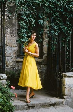 Model wears a yellow gown by Chanel, Paris, 1955. Photo by Mark Shaw.