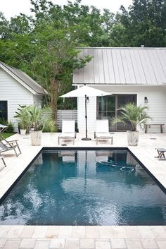 Lust Over This South Carolina Modern Bungalow Rue Magazine pool palm trees
