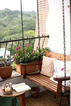 Add more spice to your balcony by transforming your boring balcony chair into a fun and elegant looking sing. Decorate the balcony edge with colorful potted plants to give out an air of coziness.