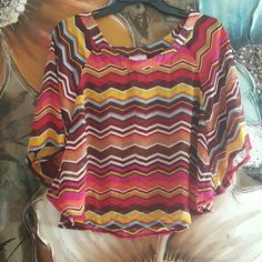 15% off*.Chevron top BUY 1 GET 2ND 8$ Super cute Chevron print flowy top. Sheer material. Short shirt. Length  Shoulder to hem 20in. From small boutique Tops Blouses