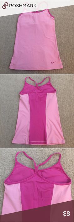 Nike Tank Top Dri Fit. Slim Fit. Tank top from Nike. Built in light support bra with removable padding. Worn once Nike Tops Tank Tops