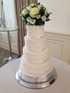 Ivory lace & pearl wedding cake with fresh flowers