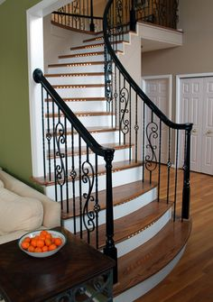 wrought iron balusters and gloss black handrail