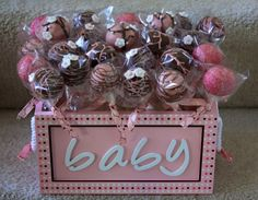 Baby shower cake pops. Pink, Brown and white. www.lauraloucakes.com