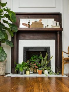 No Fire? No Problem! 4 Ways to Style Your Unused Fireplace - Home Professional Decoration Fireplace Filler, Empty Fireplace Ideas, Unused Fireplace, Candles In Fireplace, Fake Fireplace, Bedroom Fireplace, Fireplace Design, Fireplace Mantels, Fireplaces