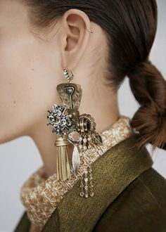 Rustic brooch and earrings collage into statement dangling single earring | Céline Catalogue Fall Winter 14/15. #design