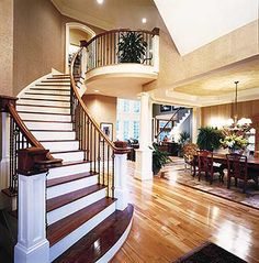 Grey Brick inside pic.  Love the double entry staircase and open dinning room.  Great floor plan!