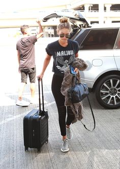 Get Gigi Hadid's comfy and casual airport style, featuring head-to-toe grey, including the new Kanye West x Adidas Originals sneakers