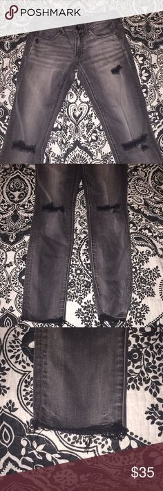 Low rise American eagle jeans Black/grey hardly worn and super comfortable! Cute distressing on the bottom and holes on the knees. Didn't wear enough because of the low rise American Eagle Outfitters Jeans Skinny
