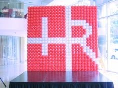 company logo in balloons . . .grid style wall