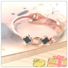 Black clovers and crystals rose gold bangle High quality. Flexible opening makes it easy to put on! Brand new in packaging. Jewelry Bracelets