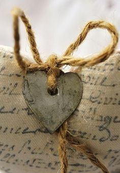 metal heart tied with jute...