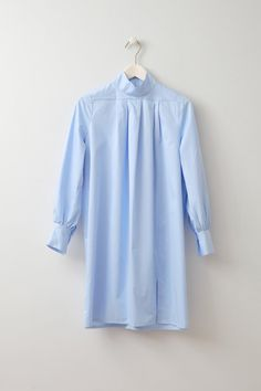 Adjazia Oversized Shirt dress Cotton shirt dress with high neck from Baum und Pferdgarten. One button closure at each cuff and a slit at front. This was an all round favourite in the NOS Crew when we placed the order and we all think it's stunning. It is properly oversized as it's got generous pleats just underneath the polo neck and it's very structured so even though it's quite short with a thigh slit, it feels very professional.