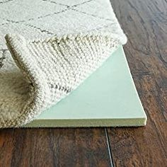 Instead of using a regular rug pad for your living room rug, try one that's made of memory foam. Feng Shui, Soundproofing Material, Soundproofing Walls, Machine Washable Rugs, Living Room Area Rugs, Living Rooms, Cheap Carpet, Large Area Rugs, Sound Proofing