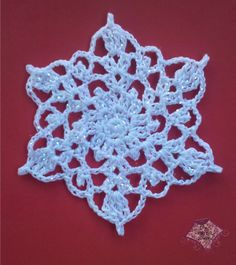Crochet Snowflake Pattern on this page {My Favourtie Snowflake Crochet Patterns} I do love these easy crochet snowflakes, and wha. Free Crochet Snowflake Patterns, Crochet Stars, Crochet Snowflakes, Thread Crochet, Crochet Motif, Crochet Crafts, Yarn Crafts, Crochet Flowers, Crochet Stitches