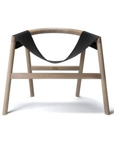 """Oak armchair - DARTAGNAN by Toni Grilo for Haymann. """"With its commitment to get to the point, Toni Grilo book Dartagnan chair. Its apparent simplicity hides a perfect mastery of curves and proportions. His swing shaped seat surprises. Everything is..."""