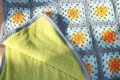 Backing a crochet blanket with fleece.