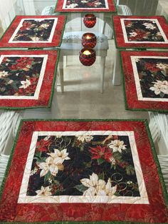These quilted Placemats are perfect for your table for the Holidays, they have beautiful poinsettias in white and red, red berries, pine cones that make them very festive. They are quilted in a swirly design with Holly leaves and berries, it totally compl Table Runner And Placemats, Table Runner Pattern, Quilted Table Runners, Christmas Quilting Projects, Christmas Sewing, Christmas Crafts, Christmas Trees, Nine Patch, Quilt Festival