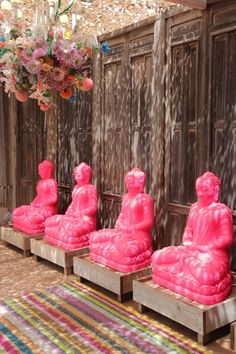 Row of Buddhas. Hot pink Buddhas. Is it okay to paint Buddhas hot pink? I have no idea ...
