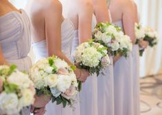 white hydrangea and rose bridesmaid bouquet with lilac dresses At Four seasons Hotel Baltimore  Maryland wedding | Photo: Dave McIntosh Photography
