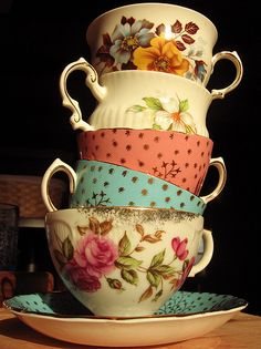 Stacked vintage tea cups by J.Caron, via Flickr.
