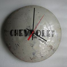 This is a vintage 1953 Chevy Truck hubcap clock. 10 Like most vintage hubcaps this one has a few nicks and dings adding to the character of Car Part Furniture, Automotive Furniture, Automotive Decor, Automotive Group, Automotive Engineering, Engineering Technology, Furniture Design, Garage Art, Man Cave Garage