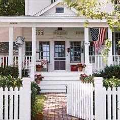 Touches of red on the front door, vintage signs, pots of geraniums, and pillows on a front-porch glider awaken this farmhouse with a rosy glow: http://www.bhg.com/home-improvement/door/exterior/farmhouse-front-door/?socsrc=bhgpin040314redallover&page=2