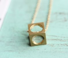 if i can hide something in this cube, i'll keep a chunk of diamond!  ,Boxed Cube Necklace