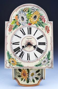 Nice hand painted Kieninger German wall clock, in a more modern adaptation of the popular Black Forest style, featuring a wooden case, hand painted over a stenciled design of flowers. Features a wind - mechanism, and includes key and pendulum.