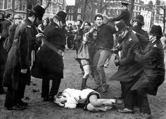 Police struggle with anti-Vietnam War demonstrators outside the Embassy of the United States in Grosvenor Square, London, on March 17, 1968.
