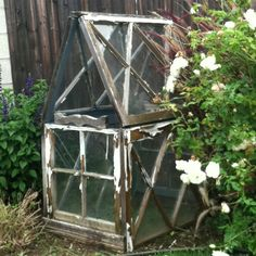 Sweetest birthday gift ever. Made with love, from recycled windows, from my hubs to me! ...A mini greenhouse.