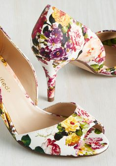 Those romantic reveries under the shade of your Magnolia tree are brought to life by donning these white floral heels. Painted in plum, rose, peach, violet, and goldenrod hues, these vegan faux-leather peep toes cultivate the garden of your soul.