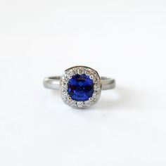 Custom made sapphire and diamond engagement ring. Designed and fabricated by J Albrecht Designs in Boulder, Colorado.