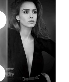 Looking in the mirror, Jessica Alba poses in Saint Laurent dress