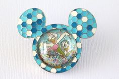 This Disney pin for sale features a bright blue Mickey head and ear shaped icon…
