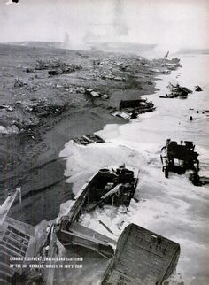 US landing equipment, smashed and scattered by the Japanese barrage, washes in the surf of Iwo Jima. 1945.