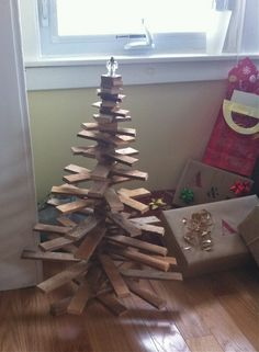 Handmade Christmas: Wood Christmas tree made with lath boards from childhood home. Folds into one flat triangle to it's easy to store. Each board can be moved around then held in place by knob on top.