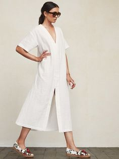 Sometimes you just need a little space. The Zoco Dress is a sheer, lightweight linen maxi dress with plenty of room to kick around. It's got an oversized fit, short sleeves and a V neckline. There's also a slit in the front so your legs can come out from time to time. We understand your needs. Please note, this fabric runs sheer. Made from surplus linen blend.